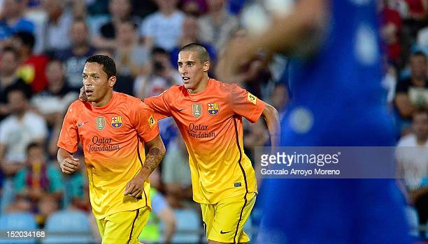Adriano Correia Claro of FC Barcelona celebrates his first goal with his teammate Tello during the La Liga match between Getafe CF and FC Barcelona...