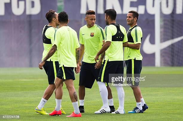 Adriano Correia Dani Alves Neymar Santos Jr Rafinha and Douglas Pereira of FC Barcelona speak during a training session ahead of their UEFA Champions...