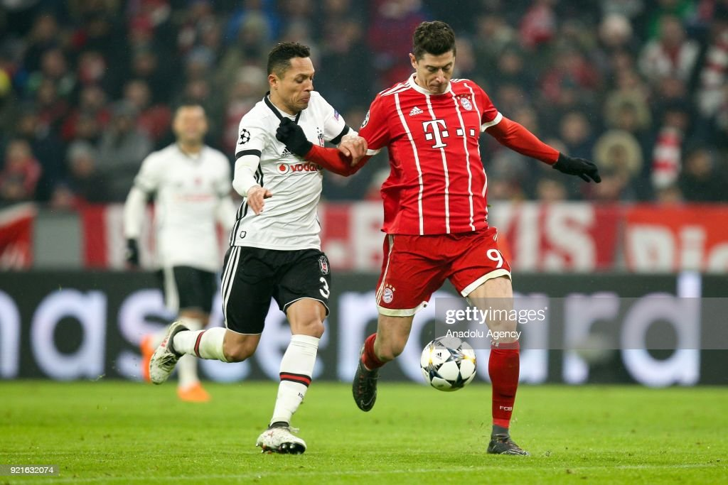 Adriano Correia (L) of Besiktas and Robert Lewandowski (R) of Bayern Munich vie for the ball during the UEFA Champions League Round of 16 soccer match between FC Bayern Munich and Besiktas at the Allianz Arena in Munich, Germany, on February 20, 2018.