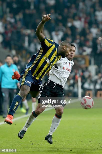 Adriano Correia of Besiktas in action against Jermain Lens of Fenerbahce during the Ziraat Turkish Cup soccer match between Besiktas and Fenerbahce...