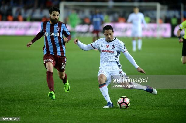 Adriano Correia of Besiktas is in action against Olcay Sahan of Trabzonspor during the Turkish Spor Toto Super Lig match between Trabzonspor and...