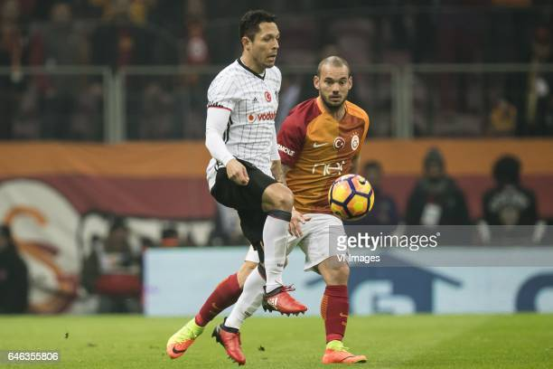 Adriano Correia of Besiktas JK Wesley Sneijder of Galatasarayduring the Turkish Spor Toto Super Lig football match between Galatasaray SK and...