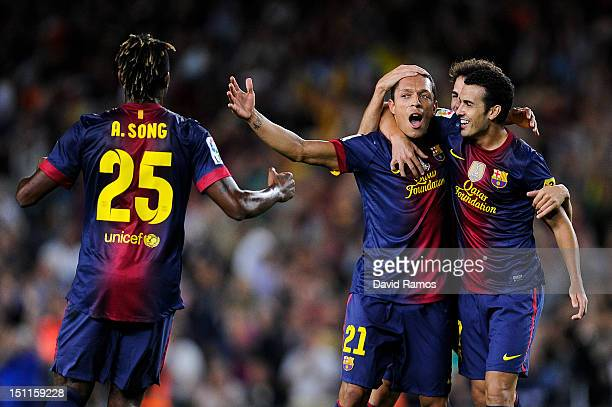 Adriano Correia of FC Barcelona celebrates with teammate Pedro Rodriguez after scoring the opening goal during the La Liga match between FC Barcelona...