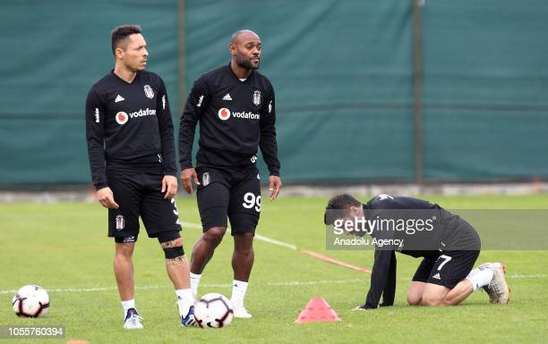 Adriano Correia Vagner Love and Gokhan Gonul of Besiktas attend a training session ahead of Turkish Super Lig match against Medipol Basaksehir in...