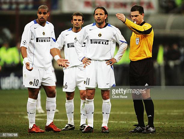 Adriano Cristaino Zanetti and Sinisa Mihajlovic of Inter Milan stand with referee Terje Hauge at a free kickduring the UEFA Champions League match...