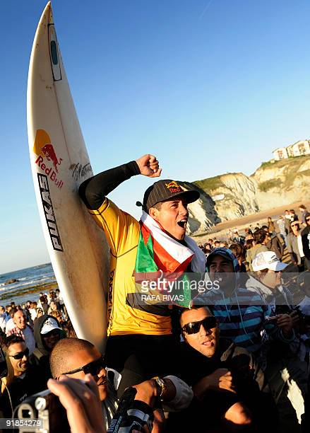 Adriano de Souza of Brazil celebrates his victory at the ASP Billabong pro Mundaka surfing World Championships finals on October 13 in the northern...