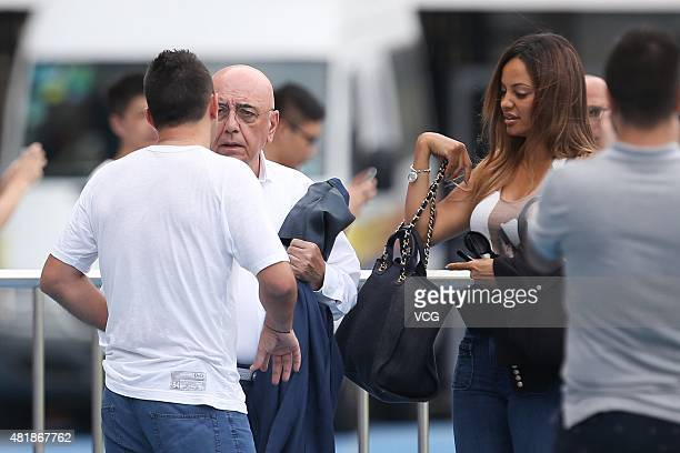 Adriano Galliani and Helga Costa speak with Cosmin Contra, former coach of Guangzhou R&F, during a training session at Shenzhen Stadium ahead of the...