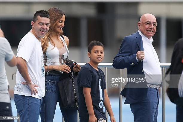 Adriano Galliani, Helga Costa and Cosmin Contra , former coach of Guangzhou R&F, react during a training session at Shenzhen Stadium ahead of the...
