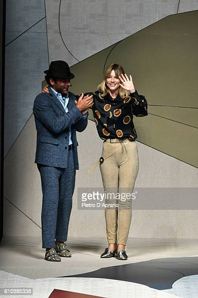 Adriano Giannini and Gaia Trussardi acknowledge the applause of the audience at the Trussardi show during Milan Fashion Week Spring/Summer 2017 on...