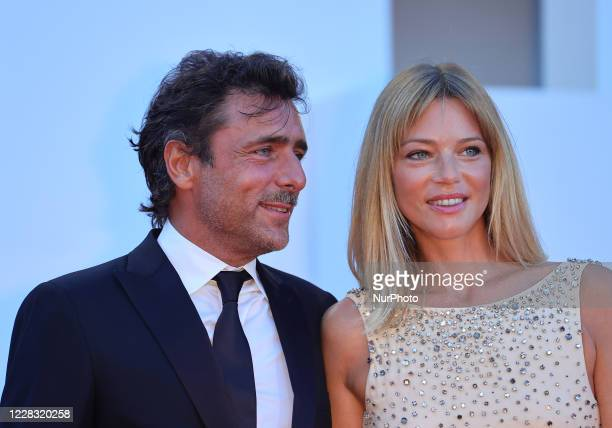Adriano Giannini and Gaia Trussardi poses on the red carpet during the 77th Venice Film Festival on September 02, 2020 in Venice, Italy.