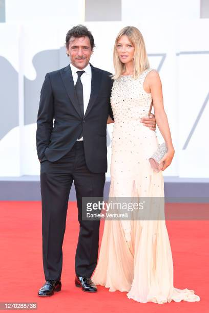 "Adriano Giannini and Gaia Trussardi walk the red carpet ahead of the Opening Ceremony and the ""Lacci"" red carpet during the 77th Venice Film Festival..."