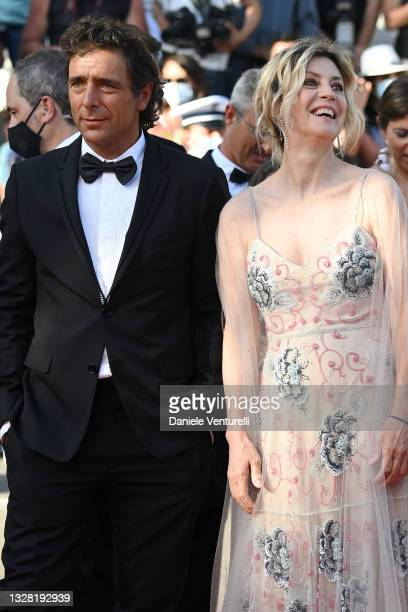 """Adriano Giannini and Margherita Buy attend the """"Tre Piani """" screening during the 74th annual Cannes Film Festival on July 11, 2021 in Cannes, France."""