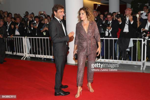 Adriano Giannini and Valeria Golino walk the red carpet ahead of the 'Emma ' screening during the 74th Venice Film Festival at Sala Grande on...