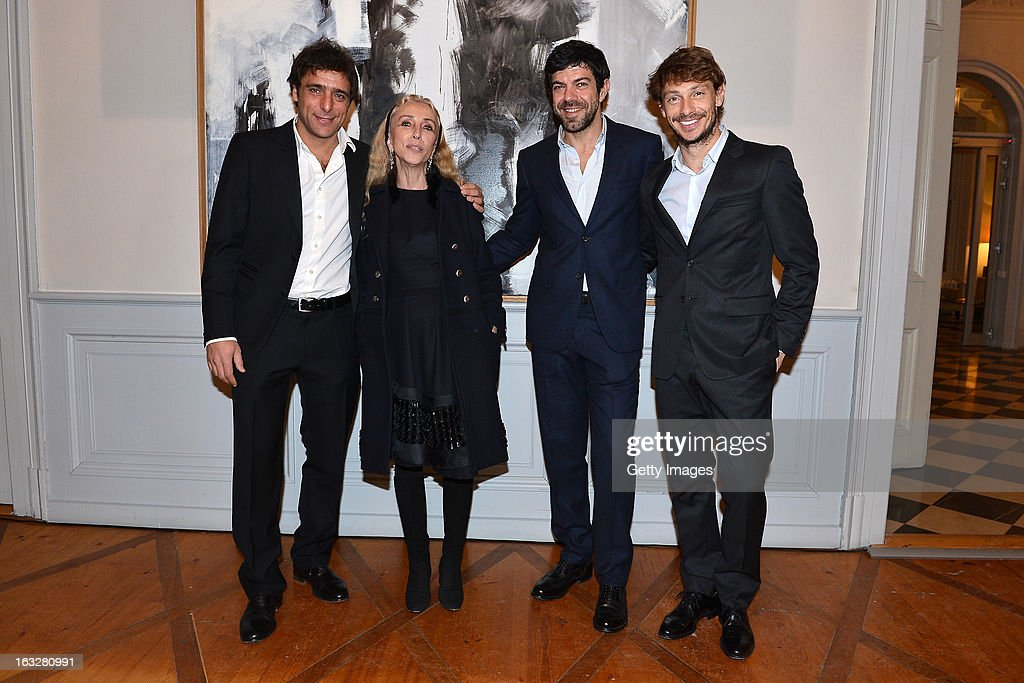 Adriano Giannini, Franca Sozzani, Vogue Italia Editor in Chief, Pierfrancesco Favino and Giorgio Pasotti attend the charity auctioning of the first 'Citroen DS3 Cabrio L'Uomo Vogue' hosted by L'Uomo Vogue and Citroen at the Permanent Mission of France to the United Nations Office on March 6, 2013 in Geneva, Switzerland.
