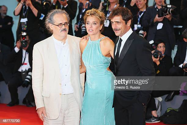 Adriano Giannini Valeria Golino and Giuseppe Gaudino attend a premiere for 'Per Amor Vostro' during the 72nd Venice Film Festival at Palazzo del...
