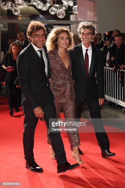 Adriano Giannini Valeria Golino and Silvio Soldini walk the red carpet ahead of the 'Emma ' screening during the 74th Venice Film Festival at Sala...