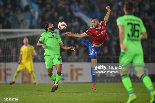 Adriano Grimaldi of 1860 Muenchen and Marc Endres of Unterhaching compete for the ball during the 3 Liga match between SpVgg Unterhaching and TSV...