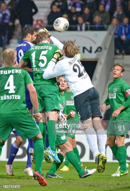 Adriano Grimaldi of Osnabrueck scores his teams first goal against Robin Neupert, Simon Scherder, Daniel Masuch and Jens Truckenbrod of Muenster...
