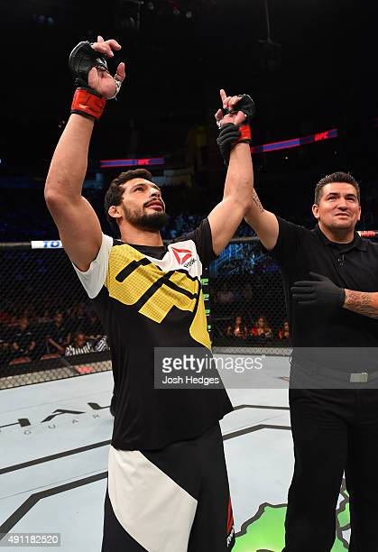 Adriano Martins celebrates his knockout victory over Islam Makhachev in their lightweight bout during the UFC 192 event at the Toyota Center on...