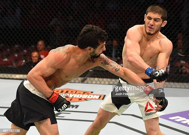 Adriano Martins punches Islam Makhachev in their lightweight bout during the UFC 192 event at the Toyota Center on October 3 2015 in Houston Texas