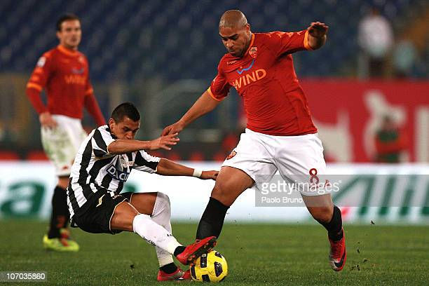 Adriano of AS Roma competes for the ball with Alexis Alejandro Samchez of Udinese Calcio during the Serie A match between AS Roma and Udinese Calcio...
