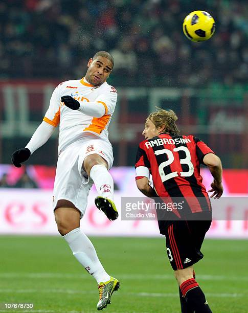 Adriano of AS Roma competes for the ball with Massimo Ambrosini of AC Milan during the Serie A match between AC Milan and AS Roma at Stadio Giuseppe...
