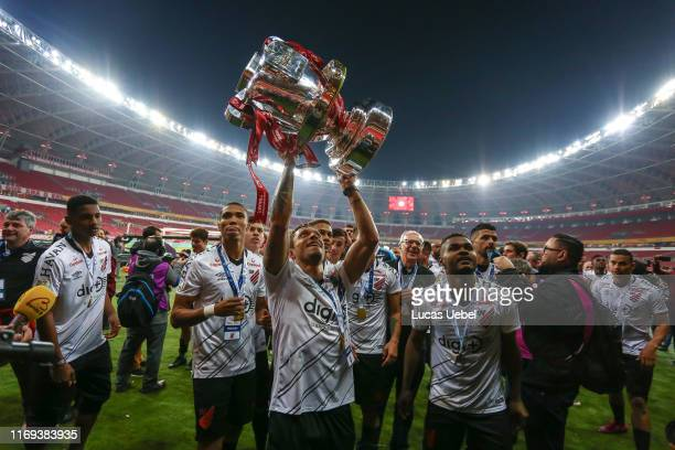 Adriano of Athletico PR and teammates celebrate with the trophy after a match between Internacional and Athletico PR as part of Copa do Brasil Final,...