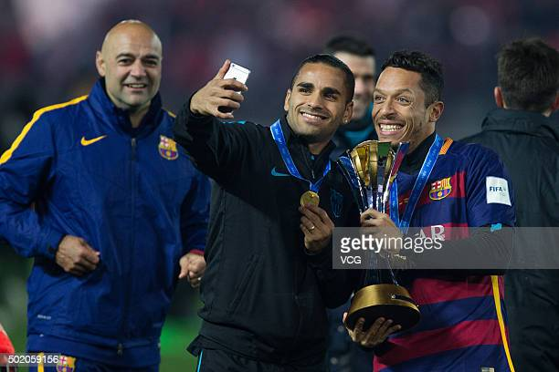 Adriano of Barcelona celebrates with the trophy after winning the FIFA Club World Cup Final Match between FC Barcelona and River Plate at...