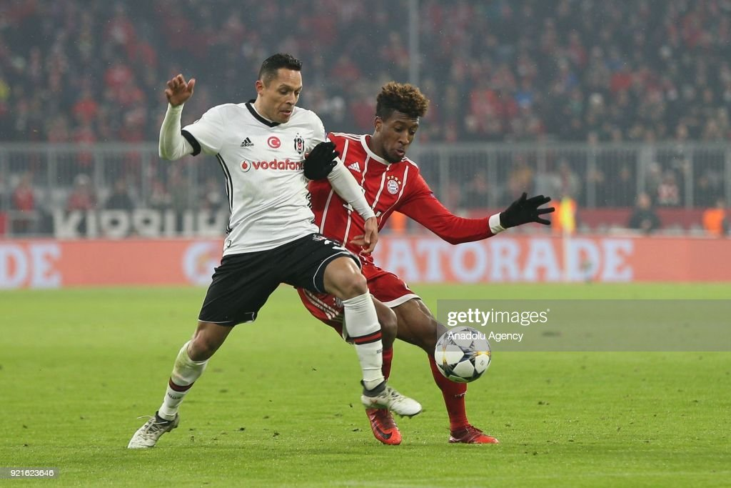 Adriano (L) of Besiktas in action against Kingsley Coman (R) of FC Bayern Munich during the UEFA Champions League Round of 16 soccer match between FC Bayern Munich and Besiktas at the Allianz Arena in Munich, Germany, on February 20, 2018.
