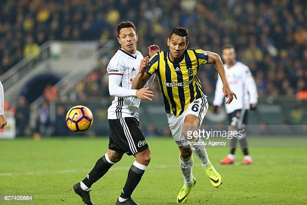 Adriano of Besiktas in action against Souza of Fenerbahce during the Turkish Spor Toto Super Lig match between Fenerbahce and Besiktas at Ulker...