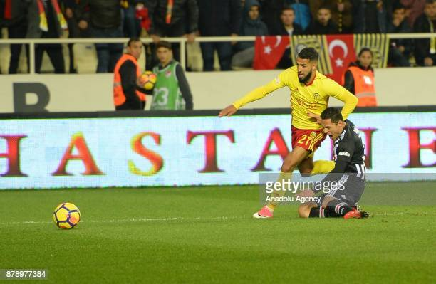 Adriano of Besiktas vies for the ball against Issam Chebake during the Turkish Super Lig soccer match between Evkur Yeni Malatyaspor and Besiktas at...