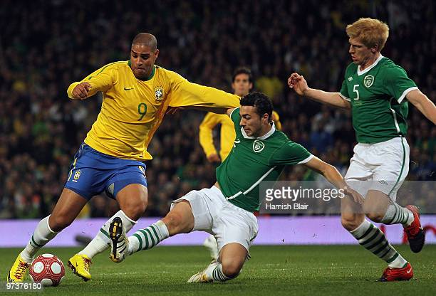 Adriano of Brazil contests with Stephen Kelly and Paul McShane of Ireland during the International Friendly match between Republic of Ireland and...