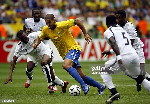 Adriano of Brazil cuts through the Ghanaian defence during the FIFA World Cup Germany 2006 Round of 16 match between Brazil and Ghana at the Stadium...