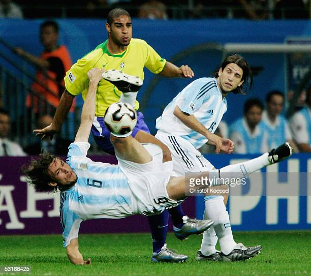 Adriano of Brazil is challenged by Gabriel Heinze and Diego Placente of Argentina during the FIFA 2005 Confederations Cup Final between Brazil and...