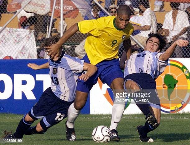 Adriano of Brazil is chased by Emiliano Giaunzio and Mauro Rosales of Argentina during a match on 28 January 2001 at the South American Soccer...