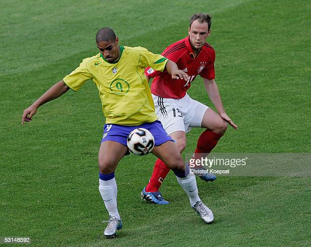 Adriano of Brazil is tackled by Fabian Ernst of Germany during the Semi Final Match between Germany and Brazil for the FIFA Confederations Cup 2005...