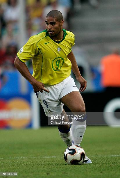 Adriano of Brazil runs with the ball during the match between Japan and Brazil for the Confederations Cup 2005 at the RheinEnergie Stadium on June 22...