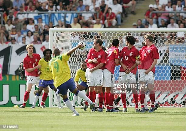 Adriano of Brazil scores the opening goal from a freekick during the 2005 FIFA Confederations Cup semi final match between Germany and Brazil at the...