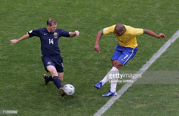 Adriano of Brazil shoots and scores the first goal during the FIFA World Cup Germany 2006 Group F match between Brazil and Australia at the Stadium...