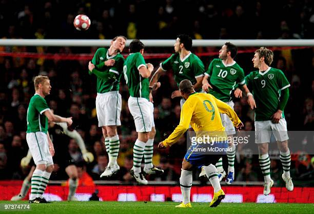 Adriano of Brazil takes a free kick during the International Friendly match between Republic of Ireland and Brazil played at Emirates Stadium on...