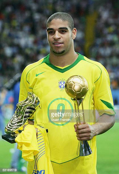 Adriano of Brazil with his Adidas Golden Shoe and Adidas Golden Ball awards following the FIFA 2005 Confederations Cup Final between Brazil and...