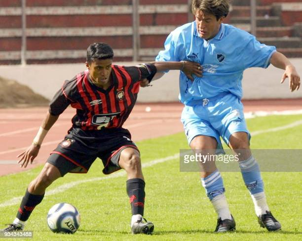 Adriano of Brazil's Atletico Paraense team keeps the ball away from bolivian Carmelo Sanchez 12 March 2002 in La Paz during the Libertadores de...