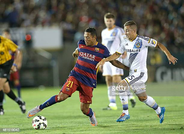 Adriano of FC Barcelona controls the ball against Ignacio Maganto of the Los Angeles Galaxy in the International Champions Cup 2015 at Rose Bowl on...