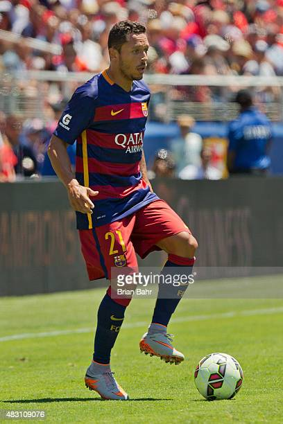 Adriano of FC Barcelona looks to center the ball against Manchester United FC in the first half during the International Champions Cup on July 25...