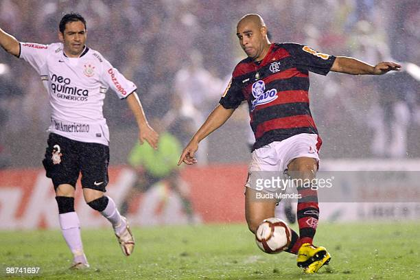 Adriano of Flamengo fights for the ball with Chicao of Corithians during their match as part of Libertadores Cup at Maracana Stadium on April 28 2010...