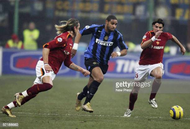 Adriano of Inter is challenged by Philippe Mexes and Simone Perrotta of Roma during the Serie A match between Inter Milan and SS Roma played at the...
