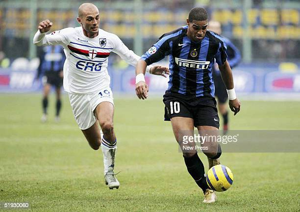Adriano of Inter Milan runs ahead of Giulio Falcone of Sampdoria during the Serie A match between Sampdoria and Inter Milan at the Giuseppe Meazza...