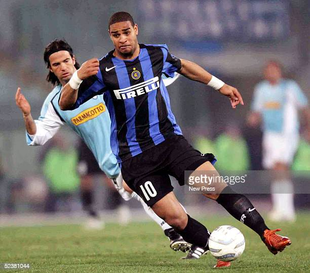 Adriano of Inter Milan struggles for the ball against Fernando Couto of Lazio during their match March 12 2005 in Stadio Olimpico in Rome Italy