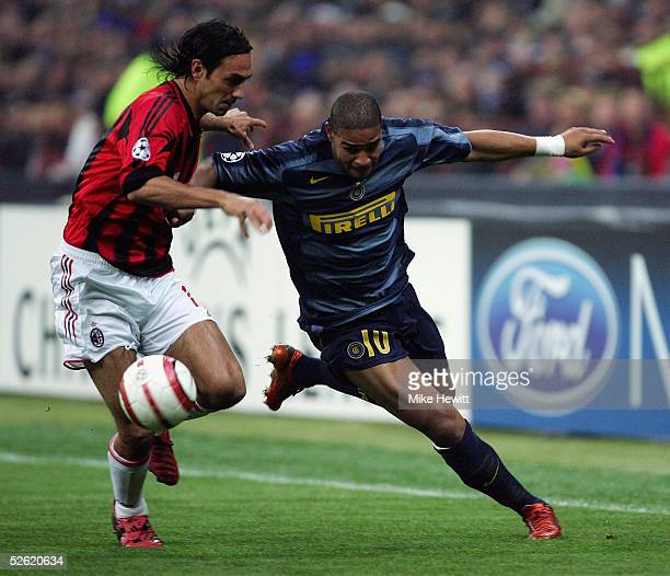 Adriano of Inter Milan struggles to get past Alessandro Nesta of AC Milan during the UEFA Champions League quarter-final second leg between AC Milan...