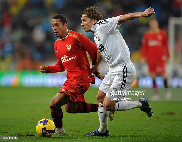 Adriano of Sevilla duels for the ball with Michel Salgado of Real Madrid during the La Liga match between Real Madrid and Sevilla at the Santiago...